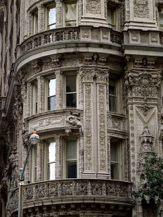 Alwyn Court dragon~ 12-story apartment building located at 180 West 58th Street  Midtown Manhattan, NYC  built between 1907 and 1909, and was designed by Harde & Short in French Renaissance style, with elaborate terra-cotta ornamentation in the Francis I style covering the entire facade.[2] The interior courtyard has a painted architectural facade by artist Richard Haas.[3]  The building was constructed with 14-room 5-bathroom apartments which were subdivided during the Depression