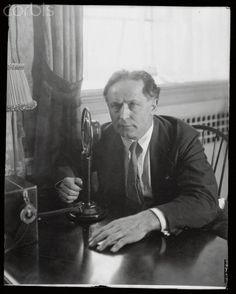 14 October 1926. Harry Houdini Broadcasting Show  Original caption:Harry Houdini, magician and ghost destroyer, at the microphone broadcasting over WGY.