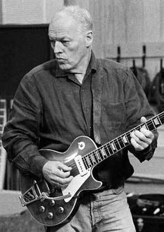 """David Gilmore with a rare use of a Les Paul. He recorded """"Time"""" and a few others with humbucker guitars so this would be a great option for that uncommon Gilmour sound. He liked the warm sound of them for the bridge pickup, but preferred the Strat neck."""