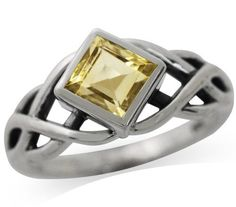 Celtic Knot Solitaire Ring in Sterling Silver with Natural Citrine stone.
