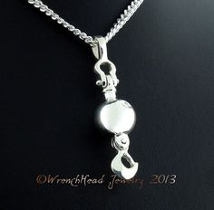 Sterling Silver Crane Ball and Hook Pendant by WrenchHeadJewelry, $349.00