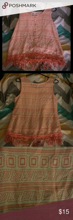 Tribal Print Shirt White and dark pinkish/ orange color;  faux button up front;  fringe like bottom;  Never worn mine Tops Tank Tops