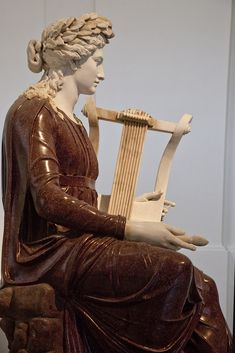 Apollo with Lyre  Archeological Museum, Naples. Porphory and marble. 2nd half of 2nd century CE. Farnese 6281.
