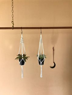 This small macrame plant hanger is handmade with 3mm natural white cotton rope and hung by a small brass ring. Hang a few together to showcase a variety of pots and plants! Makes a lovely gift! Measures approx. 25 long. Hanging length will vary depending on the size and shape of pot