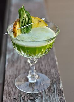 Recipe for Fever Pitch Cocktail, with cachaca, pineapple, basil, green chartreuse, lime, egg white, and celery bitters. Brazilian-themed for the World Cup!