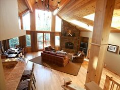 View of kitchen, breakfast bar, dining rm and glass wall into forest.  4 bd + den/4.5 baths (sleeps 8-15)