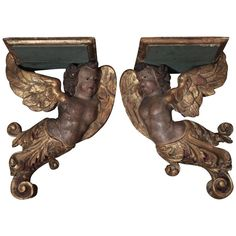9800 Pair of Century Italian Polychrome and Parcel-Gilt Wall Brackets 1