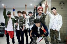 BTS, trying to look all bad ass but, there is j-hope who has an 'o' face and v who looks confused cx