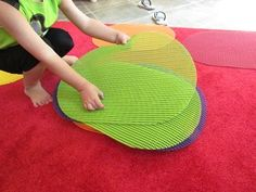 """Placemats used as """"spots"""" for circle time. Much easier to find than those carpet squares.  If you have morning meeting or circle time in a special education classroom, these are perfect.  Less likely to slide around and provides a clear visual cue as to where to sit.  Read more at:  http://www.teachpreschool.org/2011/08/preschool-circle-time-idea-grab-a-spot/"""