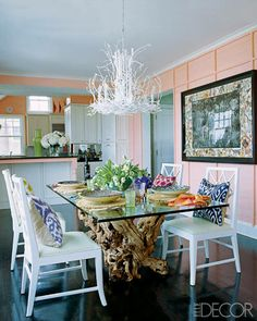 A Colorful Hamptons Home - ELLE DECOR  Beachy pink, dark floors, black frame with whites .s