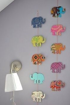 DIY Elephant Art - Get scrapbook paper, tape and ribbon. Look for a stencil of your favorite animal or shape online, print and trace onto the scrapbook paper.