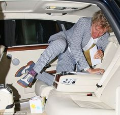 Mind your step: Instead of using the second door on the car, Rod rolled into their plush Rolls Royce after dinner