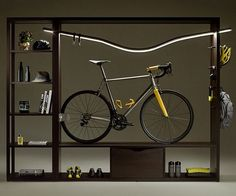 Maximize the limited space in your home by placing your trusty ride on display within the Vadolibero indoor bike shelf. This elegant shelf sports a dark wood finish, provides ample shelf space, and is specially designed to fit neatly inside.
