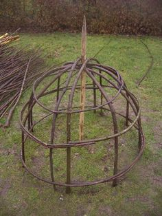Wattle cloche provide visual appealing supports for peonies and other top heavy flowers I would love to try to make these for my peonies and heaviest Iris. Potager Garden, Veg Garden, Garden Trellis, Garden Art, Garden Plants, Garden Design, Peony Support, Garden Plant Supports, Garden Cloche