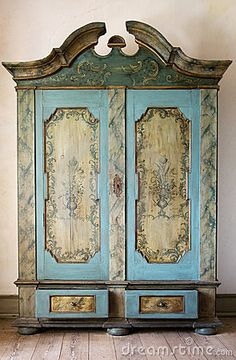 Antique painted cupboard by Lorna, via Dreamstime
