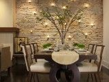 my fav dining room look. Love the stone wall with lights and the modern table. also love color scheme and ambiance.