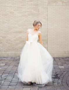 Genevieve gown and tulle overskirt by Mignonette Bridal, featured on Green Wedding Shoes today!