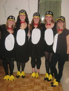 Homemade cheap penguin halloween costumes from a few years ago. Basic directions: Wear black dress. Glue yellow felt on bill of black hat, and white and black fabric for the eyes. Buy or make red bow ties - we bought. Cut out and pin white fabric oval on dress. Cut out yellow felt feet and leave a thin strip at the back. Either tuck that strip into your shoes, or glue the strip around a hair tie and wrap it around ankles. (Make extra feet if you plan on wearing more than one night!)