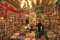 Shakespeare and Company bookstore In Paris France. I could've spent the whole day there:)