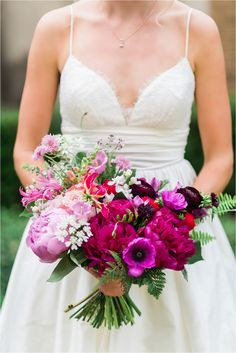 We love this bridal bouquet in pink and purple hues (with plenty of peonies) by Statice Florals! // Photo by Hannah Woodard Photography // www.hannahwoodardphotography.com