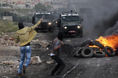 WEST BANK PROTEST: Palestinian protesters threw stones toward Israeli troops during clashes in Kfar Qaddum, West Bank, Friday. Today Pictures, Troops, Friday, Stones, Women, Rocks, Rock, Woman