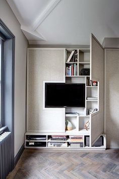 Wall TV Cabinet Storage Wall in Small Space Flat Design Ideas. A wal mounted storage cupboard bookcase that is also a Cabinet TV. Design ideas to make this small flat feel bigger.