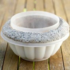 Make a concrete planter with old plastic ware for forms. Put drain hole in bottom before It dries