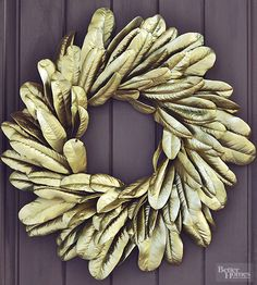 Take nature up a notch by turning what was once green into gold. Add a couple coats of glitzy gold spray paint to large-scale magnolia leaves that were formed into a wreath. The layered metallic leaves make a statement all on their own -- no embellishment required.