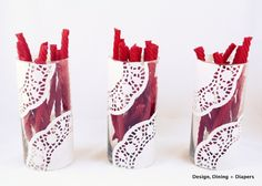 Doily vases filled with licorice for a Valentine's Day treat!