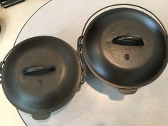 Lodge nos 7 & 8 dutch ovens with logo and later style handle. Lodge Cast Iron, Dutch Ovens, It Cast, Handle, Tools, Logo, Vintage, Style, Wrought Iron
