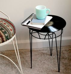 Upgrade an old side table with a vinyl record.