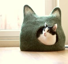 "Cats love to lounge in boxes, but having a bunch of empty cartons in your home adds little in terms of decor. Agne Audejiene of Agnes Felt creates colorful felted ""cat caves"" that provide your feline with cozy places to sleep and stalk while incorporating a stylish, modern pet accessory into your home. Available in a …"