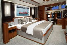 """Split-level on deck master stateroom featuring 280 degrees visibility with a contemporary interior by award winning Patrick Knowles Designs on board 2009 Trinity Yachts """"Rockstar"""""""