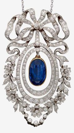 A Belle Époque sapphire, diamond and platinum-topped drop necklace, J.E. Caldwell & Co. Of foliate and ribbon motif centring an articulated oval-cut sapphire in a double articulated surround set with old single and full-cut diamonds, signed J.E.C. & Co. and numbered. #Caldwell #BelleEpoque #pendant
