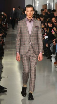 A model walks the runway at the Richard James show during The London Collections: Men Autumn/Winter 2014 (Picture: Anthony Harvey/Getty Imag...