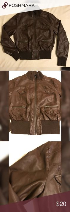 Ambiance Faux Leather Jacket Dark brown in color. Size L but would fit a M as well. Has slight peeling on right arm, barely noticeable. Buttons are decoration, but has small zipper pockets. Big zipper works. Great pick for Fall/Winter. Ambiance Jackets & Coats