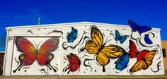 350 W 19th St---#ILoveYouWall (butterflies). Painted on the side of Harold's in the Heights