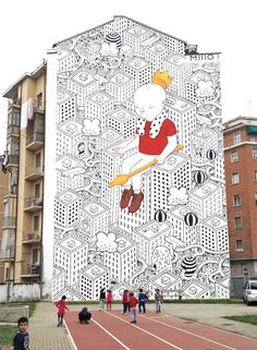 Italian artist Millo won a competition that enabled him paint 13 multi-story murals in Turin.