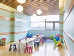 The pediatrics tower contains playrooms for all ages; energy-saving, color-changing LED accent lighting; and architectural features that create strong landmarks and positive distractions. Photo: Blake Marvin/HKS Inc.