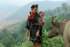 Black Hmong woman and buffalo, Sapa Vietnam by NaPix -- (Time out), via Flickr