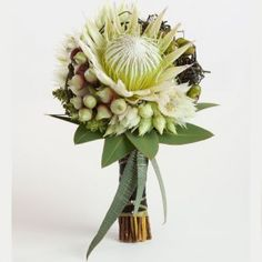 Proteas with Serruria 'blushing brides', eucalyptus buds and leaves and dodder vine.