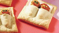 A cute alternative to the classic pig-in-blanket, these easy sandwiches layer ham, cheese and chicken patties inside crescent covers.