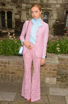 Actress Bel Powley in a Gucci Spring Summer 2016 rose lace suit, with peep-toe pumps and a blue metallic GG Marmont shoulder bag.