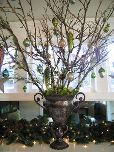 Find a tarnished or weathered old container from your favorite thrift store, scavenger some mossy branches  from outside, add some pretty reindeer moss on top and decorate with your favorite ornaments.