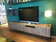 Floating cabinets for electronics in family room.