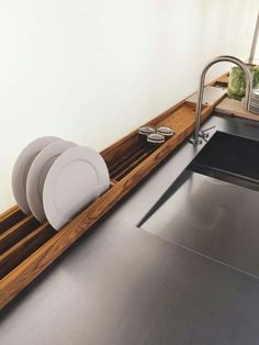 Built in drying rack! Loving the wood against thr bench top.  Source unkown