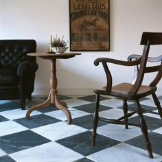 Di Scacchi Tumbled Marble. The perfect traditional black and white flooring; the Tumbled, worn finish gives the impression it has been walked on for centuries. Stone tiles from Mandarin Stone.