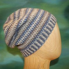 Broken stripe beanie (or slouchy) in Blacker's 14th birthday yarn Cornish Garden. Three sizes, two styles.