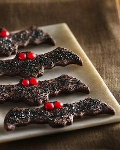 """No vampires here—just delicious chocolate cookies that are extra easy to make. Look for a bat-shaped cookie cutter in the Halloween section at your local party store, or at larger craft, grocery or baking supply stores. You might find the black decorator sugar crystals labeled as """"black sanding sugar,"""" too."""