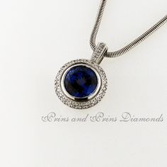 Centre stone is a round tanzanite tube set with 33 = GH/SI round brilliant cut diamonds set in an white gold halo design with diamond detail on the bale The Bale, Diamond Pendant, Halo, Centre, Tube, Sapphire, Diamonds, White Gold, Pendants